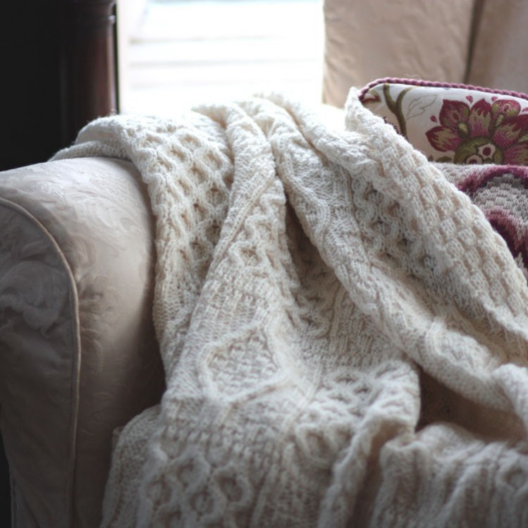 Copy Miranda's style with this Chunky knit Aran throw by the Wool company. Sex and the city set design interior inspiration.