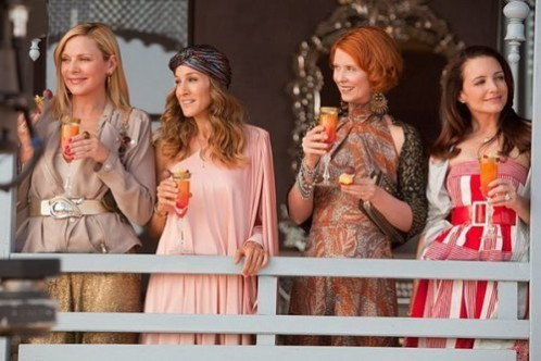 The SATC ladies enjoying the views from their glamorous Moroccan hotel balcony. Sex and the city 2 set design inspired interior design ideas.