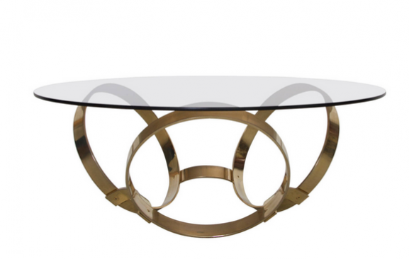 Sex and the City set design inspired interior design: Round Brass Geometric Rings Coffee Table with Glass Top