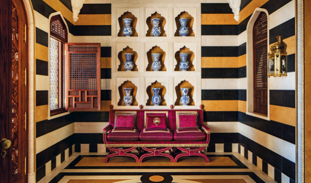 Theme of the Month: Antiques in a Contemporary Context. a wall of carved marble alcoves, each of which contains a sixteenth century Turkish blue and white mosque lamp and features Mashrabiya grillwork.