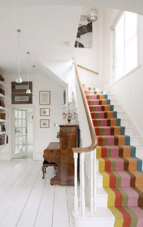 Hallway flooring ideas LOVE CHIC LIVING (2013) A striped stair runner teamed with a muted, white painted hall and landing that reflects light and maximise height. Whilst the colourful runner adds a fun element to this traditional space.