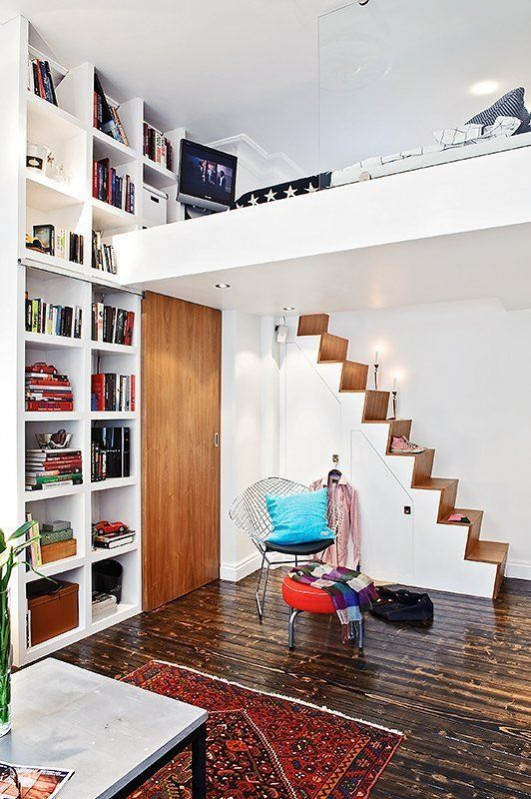 How to de-clutter your interior this January: The KonMari method, asks you to divide your belongings into categories, before reorganising. Everything has a space in your new clutter-free home like any books kept that spark joy. You can begin organising  by colour. Found on apartmenttherapy.com